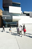 MCA Sydney. The MCAs new wing that opened to the public today 29th March 2012 at Circular quay Sydney with people entering and standing on forecourt royalty free stock images