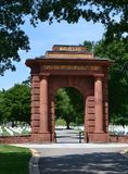 McClellan Arch at Arlington National Cemetery. The McClellan Arch stands over the graves of fallen soldiers at Arlington National Cemetery across the Potomac Royalty Free Stock Photos