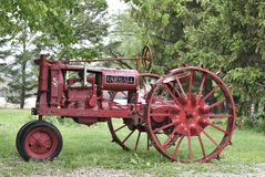 A McCormick-Deering Farmall. This is a Spring picture of an old 1940 McCormick-Deering Farmall made by the International Harvester Company.  This tractor was Stock Image