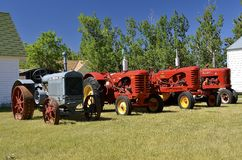 McCormick Deering, Massey Harris, and Farmal M tractors. WATFORD CITY, NORTH DAKOTA, June 23, 2016:  Vintage Massey Harris, McCormick Deering, and Farmal M Stock Photo