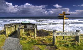 McCrackens Rest Viewpoint New Zealand. McCrackens Rest Viewpoint Sign and Distant Landscape of Great Southern Ocean in New Zealand South Island Stock Photo
