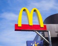 Mcdonald logo on blue sky background Stock Photography