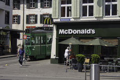 McDonald's Barfüsserplatz Basel. With a tram parked outside Stock Photo