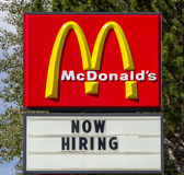 McDonald's Fast Foot Now Hiring Sign and Logo Royalty Free Stock Image