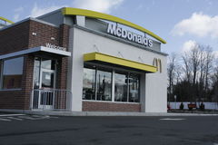 Mc Donalds Front. Front view of a McDonalds fast food restaurant Stock Photos