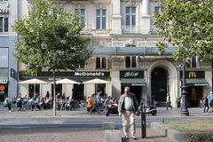 McDonald's Germany. BERLIN, GERMANY - AUGUST 27, 2014: People visit McDonald's at famous Kurfurstendamm (Ku'Damm) Avenue in Berlin. McDonald's had 36,900 Royalty Free Stock Images