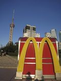 McDonalds in China: McDonalds Logo in Front of Ori. The McDonalds logo in front of the Oriental Pearl Tower in Shanghai illustrates business and international Stock Photos