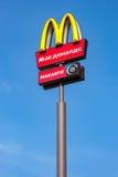 McDonald's logo on a pole against the blue sky Royalty Free Stock Photos