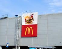 McDonald's logo on wall of shopping center. Royalty Free Stock Photos