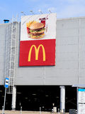 McDonald's logo on wall of shopping center. Royalty Free Stock Images
