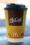 McDonald's McCafe. McDonald's coffee McCafe cup displaying the logo and names Stock Photography