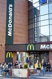 Minsk, Belarus, April 20, 2018: McDonald`s in Minsk. People sitting at tables and eating outdoors on the street Royalty Free Stock Photos