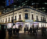 McDonald`s restaurant fast food entrance in historic building of Circular quay branch at night time. SYDNEY, AUSTRALIA – On June 3, 2019 stock photos