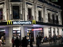 McDonald`s restaurant fast food entrance in historic building of Circular quay branch at night time. SYDNEY, AUSTRALIA – On June 3, 2019. – royalty free stock photography