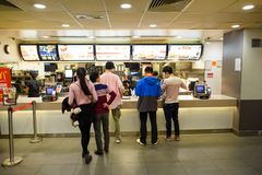 McDonald's restaurant. HONG KONG - DECEMBER 24, 2015: interior of McDonald's restaurant. McDonald's is the world's largest chain of hamburger fast food Stock Images