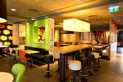 McDonald's restaurant interior. GENEVA, SWITZERLAND - NOVEMBER 19, 2015: McDonald's restaurant interior. McDonald's is the world's largest chain of hamburger Stock Images