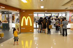McDonald's restaurant interior. HONG KONG - APRIL 03, 2015: McDonald's restaurant interior. The McDonald's Corporation is the world's largest chain of hamburger stock images