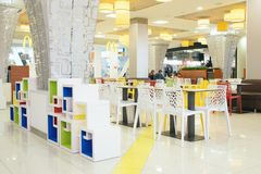 McDonald`s Restaurant interior. Modern light interior cafe royalty free stock images
