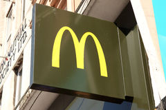 McDonald's sign. Cardiff, United Kingdom, September 14, 2016 : McDonald's new logo advertising sign outside one of it's restaurants in St Marys Stree Royalty Free Stock Image