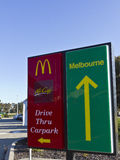 McDonalds drive through and carpark entry signs. McDonalds carpark and drive through entry signs in Outback NSW Australia Royalty Free Stock Images