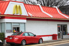 McDonalds Drive-thru Services. Cars waiting at McDonalds drive-thru services which provides fast food 24 hours every day Stock Photos