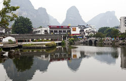 McDonalds in an idyllic landscape. A McDonald's fast food restaurant sits beside a lake in the idyllic location of Yangshuo near Guilin in southern China Royalty Free Stock Photography