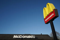 McDonalds logo on blue sky background Royalty Free Stock Photography