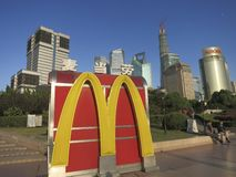 McDonalds Logo in Front of Shanghai Skyscrapers. The McDonald's logo sits in front of the major skyscrapers of Shanghai's Lujiazui. The Shanghai Tower (under Royalty Free Stock Photos