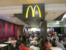 McDonalds Logo at Restaurant. The McDonalds Golden Arches logo hangs from the ceiling of a McDonalds restaurant Royalty Free Stock Images