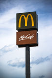 McDonalds and McCafe Signs on Post Royalty Free Stock Photography