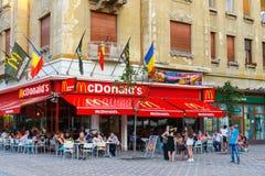 McDonalds restaurant at Piata Victoriei, Timisoara, Romania. TIMISOARA, ROMANIA - JULY 22, 2014: McDonalds restaurant at Piata Victoriei, Timisoara, Romania. Mc Royalty Free Stock Photography