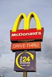 McDonalds sign. Mcdonald's sign with Drive-Thru and 24 open hours Royalty Free Stock Image