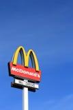 McDonalds sign. On blue sky background Stock Photo