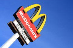 McDonalds sign. On blue sky background Royalty Free Stock Photography
