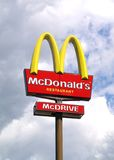 McDonalds sign. Sign from McDonalds on sky background royalty free stock photos