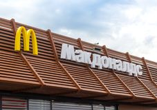 Mcdonalds signboard. On the roof, Russia, Novosibirsk, August 01, 2017 Royalty Free Stock Photo