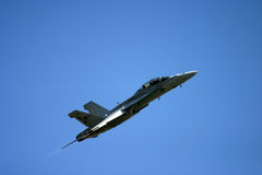 McDonnell Douglas F/A-18 Hornet. F 18 jet fighter air show royal air tattoo blue sky fast loud army air force navy RAF Fairford Royalty Free Stock Photo