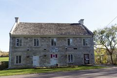 McDougall Mill Museum - Renfrew, Ontario. The McDougall Mill Museum built in 1855 is situated on the Bonnechere River in the town of Renfrew, Ontario. A swinging Stock Images