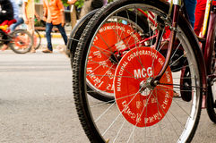 MCG branding on cycle tyre. Delhi, India; 10th Aug 2014 - Municipal corporation of Gurgaon branding on bicycle tires. These cycles are provided free of cost to Stock Photography