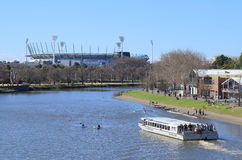 MCG and Yarra river city view Melbourne. Sightseeing boat cruises in Yarra river, MCG in background Stock Photo