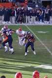 Mcgahee runs. Afc west champion denver bronco's willis mcgahee runs against kansas city chiefs. bronco,s playing in the playoffs with Tim Tebow. Notice both of royalty free stock photo