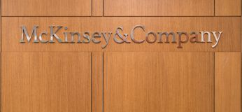 Mckinsey and Company logo at the front desk reception of Istanbul office. Istanbul, Turkey - November 2017: Mckinsey and Company logo at the front desk reception Royalty Free Stock Photo