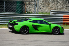 McLaren Automotive MP4-12C in action. This British Supercar runs in circuit in occasion of a test day organized by Swiss Kuno Schaer Stock Photos