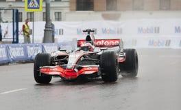 McLaren F1 Auto mit Jenson Button Stockbilder