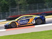 McLaren GT. Pro driver Alex Figge races the McLaren 12C GT3 for the K-Pax sponsored Race team at the professional motorsports racing event, International Motor Royalty Free Stock Photo