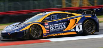 McLaren racing car. McLaren MP4-12C GT3 attacks the race track on the speedway stock images
