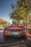 McLaren 650S Stares Down Stop Sign. Rancho Cucamonga, CA, USA - September 11, 2016: New 2017 McLaren 650S Coupe supercar crouches before a stop sign amidst Royalty Free Stock Photo