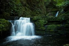 The McLean Falls on the Tautuku River in New Zealand Royalty Free Stock Images