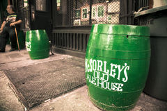 McSorley's Old Ale House Irish Pub NYC. NEW YORK CITY - AUGUST 2, 2013  Green barrels outside historic circa 1860's Irish Pub, McSorley's Old Ale House seen from Royalty Free Stock Photo
