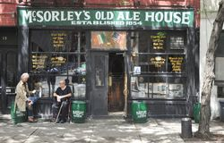 McSorley`s Old Ale House. Generally known as McSorley`s, is the oldest Irish tavern in New York City. The aged artwork, newspaper articles covering the walls Stock Image